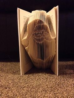 Book folding pattern for Santas Face  by BookFoldingForever