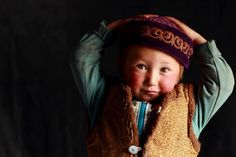 A little Mongolian Kazakh kid,he'll be another young eagle hunter. Asher Svidensky's photo