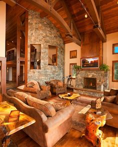 """""""Home in Sandpoint, Idaho. The painting over the fireplace slides up at the push of a button to reveal a television.  There's a big screen in the theater…"""""""
