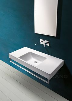 Zero Domino 100_ Washbasin with wide symmetric counters, for wall-hung, semi inset or pedestal mounted installation. 0, 1 or 3 tapholes. Front chrome brass towel-rail is available. Front chrome brass towel-rail is available.
