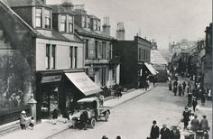 A view of Dockhead Street in Saltcoats taken around 1919. In the foreground is the Buttercup Dairies delivery van. In the background Breckenridges Ladies and Gents Hair Dressing Rooms can be seen. West Coast Scotland, Hair Dressing, Dressing Rooms, Arran, Timeline Photos, Street View, The Incredibles, Buttercup, Type 3