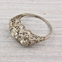 normally don't give a crap about engagement rings, but I love this vintage one. Circa 1925.