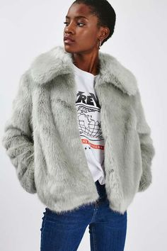 Exude glamour in this cropped fur coat in an eye-catching pale grey hue while keeping warm. Wear with a graphic tee and jeans to liven up your look. #Topshop