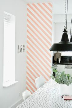 WASHI TAPE stripes on accent wall, washi tape to display photos on walls.