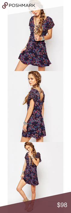 Free people yours truly dress NWT Fun and flirty free people dress! NWT size 4! Color is dark blue on tag with a fun floral print. Cute ruffles on sleeves and fun lace up detail on front! Can be laced up more than photos as well, to be less revealing! Free People Dresses