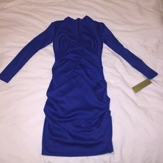 Nicole Miller Blue V-neck Dress Sexy classic blue Nicole Miller Dress. Never worn. The bottom of the dress fits like the last picture Nicole Miller Dresses Long Sleeve