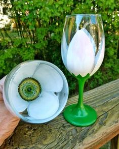 Painted wine glasses are all the rage.   Follow this simple step-by-step tutorial and you can create unique floral wine g...
