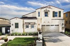 New Construction! This model home features a casita, 4 beds, 4 baths, landscaped yard.  28507 Farrier Drive, Valencia, CA.