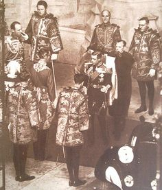 Edward VIII surrounded by heralds of the College of Arms prior to his only State Opening of Parliament, 3 November 1936
