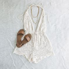 White lace, boho deep v neck romper, bridal, open back adjustable, tie, bow, with slip on tan sandals with layered gold necklace  // The Copper Closet, fashion, boutique, clothing, affordable, style, woman's fashion, women fashion, online shopping, shopping, clothes, girly, boho, comfortable, cheap, trendy, outfit, outfit inspo, outfit inspiration, ideas, Jacksonville, Gainesville, Tallahassee Florida, photo shoot, look book, flat lay, layflat, floor lay