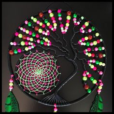 Tree of life and dream catcher green and fuchsia, 22 centimeters in diameter, 52 centimetres in length, many assorted beads, dyed pheasant feathers