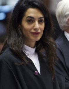 "Amal Clooney wore a purple flower pin at the ECHR court.  This pin is a Symbol of Armenian Genocide Centennial (1915-2015).  IMG_6003 (1)  100th Anniversary of the Armenian Genocide motto is ""I remember and demand,"" Forget Me Not flower is the symbol of today's briefing, explained the president's chief of staff, events dedicated to 100th anniversary of Armenian Genocide coordinating direction."