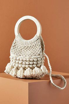 Presented by Anthropologie. Cleobella is a sophisticated collection of handmade goods woven from fine leathers, recycled materials, and fabrics acquired from local Indonesian markets. Crotchet Bags, Boho Fashion Over 40, Best Weave, Summer Handbags, Macrame Bag, Basket Bag, Summer Accessories, Fashion Bags, Purses And Bags