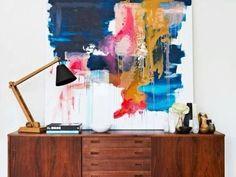 big art piece over teak credenza
