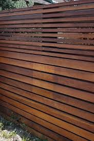 Fence idea. Love the graduated horizontal slats -would also be a nice skirt under a deck.