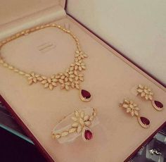 Gold diamond ruby set necklace earrings bracelet ring