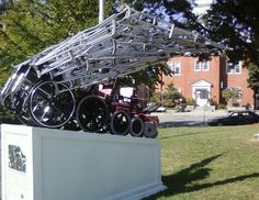 Sculpture of wheelchairs and canes by James Kitchen, commissioned by Stavros Center for Independent Living in Greenfield MA.