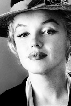 Marilyn Monroe by Milton Greene.  I find this portrait fascinating, unlike any other photo I know of MM, 1956.