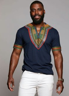 This bold and stunning African dashiki print black t-shirt is a must have for any guy's collection. Shop for all of your African attire today right here! Dashiki For Men, African Dashiki, African Wear, African Attire, African Style, African Fashion Designers, African Inspired Fashion, African Print Fashion, Africa Fashion