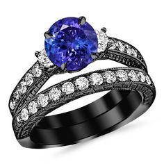 3.03 Carat 14K Black Gold Three Stone Vintage With Milgrain & Filigree Bridal Set with Wedding Band & Diamond Engagement Ring with a 2 Carat Natural Tanzanite Center (Heirloom Quality) Houston Diamond District http://www.amazon.com/dp/B00IAESEO2/ref=cm_sw_r_pi_dp_dPS1tb1R1BAFVGQF