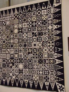 Dear Jane quilt in black and white and grey.
