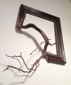 Wood frame with grafted manzanita branch - Oscar. $215.00, via Etsy.