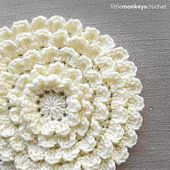 This beautiful crochet appliqué can be made with any yarn and appropriately-sized hook. Instructions are included for adding as many rounds as you desire, and the flower will only ever get wider (not taller), making it perfect for blankets, purses, or anywhere else you need a statement-sized embellishment.