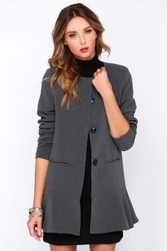 Take your dressy-meets-casual look up a notch with the Glamorous Business Classic Grey Coat! A sleek collarless cut tops this grey woven coat, falling into a full button placket with hidden top snap button, and large black round buttons at front. Lightly padded shoulders add shape, while the long sleeves offer a cozy fit. Two front slit pockets rest above the lovely ruffled hem. Fully lined. Shell: 65% Polyester, 30% Viscose, 5% Elastane. Lining: 100% Polyester. Hand Wash Cold. Imported.