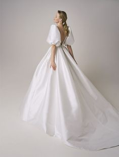 If you love Princess Diana's wedding dress or you're a bridal trendsetter, you'll want to hear the news: taffeta wedding dresses are back! Style 246 by Jesus Peiro