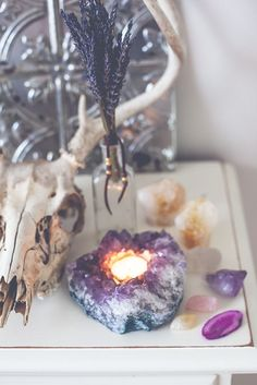 Stunning, large amethyst cluster, comes with one tea light. When the candle is lit, this beautiful crystal glows in such an ethereal way. The perfect touch of magical and romantic light for your bohem