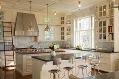 Traditional Kitchen with Complex Marble, Inset cabinets, Wood counters, Breakfast bar, flush light, Soapstone counters