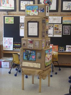 Cardboard Box display space--Think Outside the Box.  Could also be built to resemble a spaceship or pyramid or mountain or have hands at each level reaching for the top.