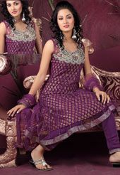 We offer a variety of salwar suits created from one of the finest materials.  Keep ahead in fashion race with this lovely purple net churidar Anarkli style kameez. This beautiful kameez is showing some amazing embroidery done with stone, sequins, zari, and patch work. Matching purple  churidar and dupatta comes along with this to add the glam. Slight variation in colour and patch patti pattern is possible.