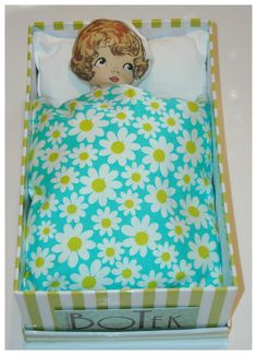 Little doll in shoe-box bed