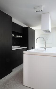 Black and white kitchen designed by Co.Studio _