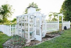 Landscape Gardeners Are Like Outside Decorators! Diy Rustic Window Greenhouse - Take The Full Tour Of This Hand Built Greenhouse Made Out Of Antique Windows Inside and Out Outdoor Greenhouse, Cheap Greenhouse, Backyard Greenhouse, Greenhouse Plans, Homemade Greenhouse, Old Window Greenhouse, Pallet Greenhouse, Greenhouse Wedding, Landscape Arquitecture