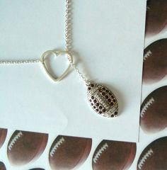 Football Necklace with Rhinestones and Heart and Number, handmade jewelry. $27.50, via Etsy.