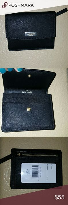 """*NEW* kate spade """"laurel way"""" black wallet This brand new black kate spade """"laurel way"""" wallet is adorable and compact. The front  has the gold signature emblem  with a gold snap closure with 2 cardholder pockets. The inside has the kate spade signature lining with 5 cardholder pockets.  The back has additional storage with a gold zipper as well as a see through spot for your ID.  This wallet measures:  Across -4.375 in. Height -3.625 in. kate spade Bags Wallets"""