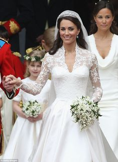 Miss Catherine Elizabeth Middleton on her wedding day to Prince William Arthur Philip Louis. The couple married in Westminster Abbey. New tittle is Her Royal Highness The Duchess of Cambridge Countess of Strathearn and Lady Carrickfergus. On the morning of their wedding day on 29 April 2011,  Buckingham Palace announced that in accordance with royal tradition and on recognition of the day by the Queen, Prince William was created Duke of Cambridge, Earl of Strathearn and Baron Carrickfergus.