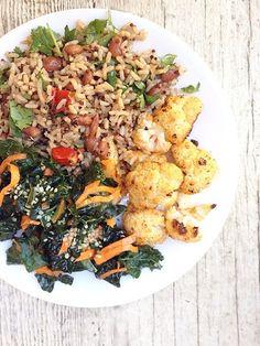 Dinner: Sriracha roasted cauliflower with brown Jasmine, Pinto beans, heirloom tomato, chopped kale & carrot salad. #vegan #flexitarian