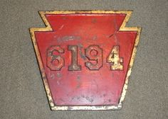 Altoona Works. A keystone number plate from PRR 6194 Q2 4-4-6-4