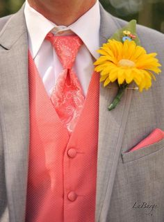 Groomsmen coral paisley tie, sunflower boutonnière  with button accent.