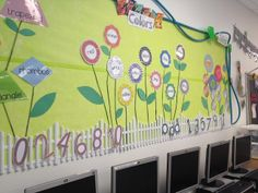 Use a garden hose as a border to create a unique and garden theme bulletin board.