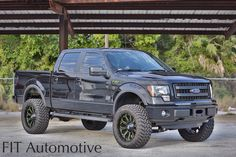 Lifted Ford trucks. XD Bomb wheels. Ford truck with custom painted wheels. Green. Lifted truck. F150