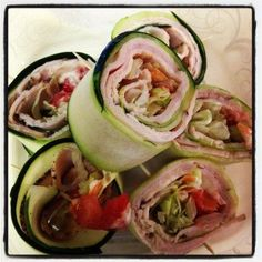 Peeled Cucumber Slices (using a vegetable peeler, take off cucumber skin, then continue to peel the cucumber around the seeded middle) 3 slices of real, unprocessed deli meat (I used turkey) Half a tomato, diced Shredded carrot Shredded lettuce Paleo mayo (optional) Toothpicks Check out THIS page for the full recipe!