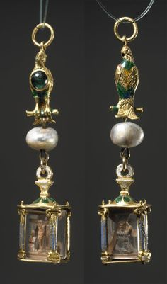 Pendant-reliquary; gold; enamelled four sides of rock crystal; gold enamelled column at each corner; inside, in the round, wood carvings of the Crucifixion and Christ bearing the cross; loop for attachment to baroque pearl; gold bird, enamelled, breast set with cabochon emerald. ca. 1580-1630, made in: Mexico, made in: Spain, wood, rock crystal, pearl, gold, enamel, emerald, length: 2.6 inches