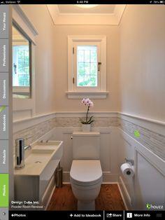 Half bath- tile above wainscoting. Love this! Like the tile and the wainscotting and the slim sink