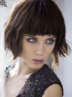 Textured bob haircut with a straight fringe. A messy surface was created with the styling.