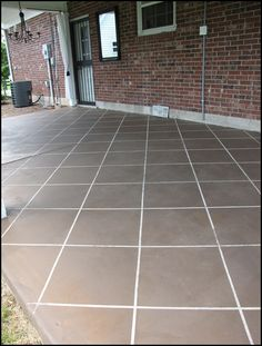 Well, we finally finished staining our concrete patio to look like tile! This was is what our concrete patio looked like before. Dull an. Tile Patio Floor, Patio Flooring, Tile Flooring, Flooring Ideas, Concrete Patios, Pavers Patio, Patio Stone, Concrete Walkway, Cement Patio