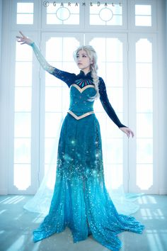 "Elsa cosplay from ""Frozen"" by tomiaaa - Looking at the original blog post this came from, it looks like this is a Photoshop of two different dresses. That, or she had deliberately made one that showed elements of both of Elsa's costumes just for the effect seen in ""Let It Go""."